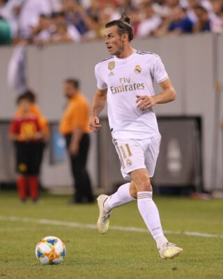 Jul 26, 2019; East Rutherford, NJ, USA; Real Madrid forward Gareth Bale (11) dribbles the ball against Atletico de Madrid during the second half of an International Champions Cup soccer series match at MetLife Stadium. Mandatory Credit: Brad Penner-USA TODAY Sports