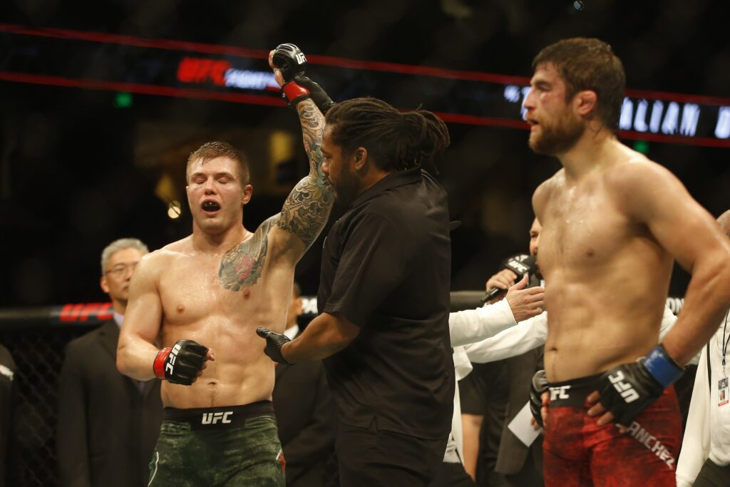 Oct 12, 2019; Tampa, FL, USA; Marvin Vettori (red gloves) celebrates after defeating Andrew Sanchez (blue gloves) during UFC Fight Night at Amalie Arena. Mandatory Credit: Reinhold Matay-USA TODAY Sports