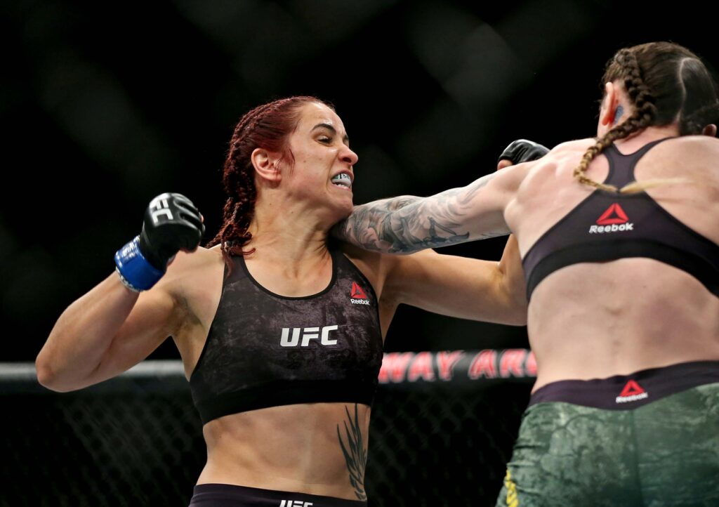 Feb 29, 2020; Norfolk, Virginia, USA; Megan Anderson (red gloves) fights Norma Dumont (blue gloves) during UFC Fight Night at Chartway Arena. Mandatory Credit: Peter Casey-USA TODAY Sports