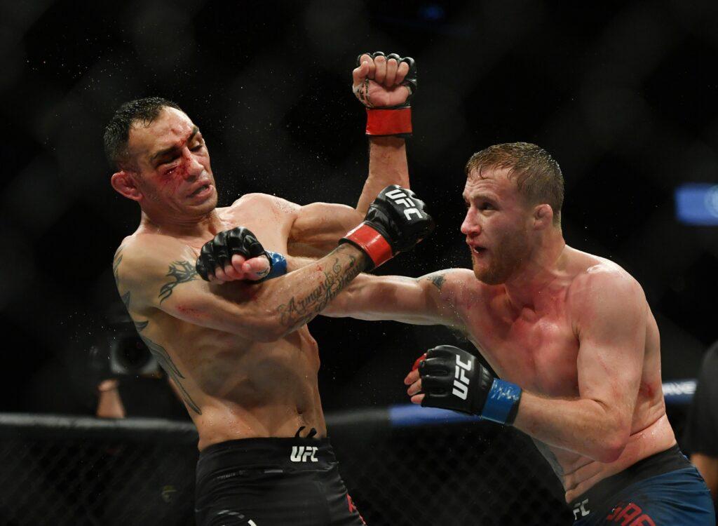 May 9, 2020; Jacksonville, Florida, USA; Tony Ferguson (red gloves) fights Justin Gaethje (blue gloves) during UFC 249 at VyStar Veterans Memorial Arena. Mandatory Credit: Jasen Vinlove-USA TODAY Sports