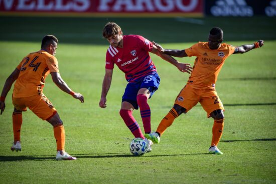 Oct 31, 2020; Frisco, Texas, USA; FC Dallas midfielder Tanner Tessmann (15) and Houston Dynamo forward Carlos Darwin Quintero (23) and midfielder Darwin Ceren (24) in action during the game between FC Dallas and the Houston Dynamo at Toyota Stadium. Mandatory Credit: Jerome Miron-USA TODAY Sports
