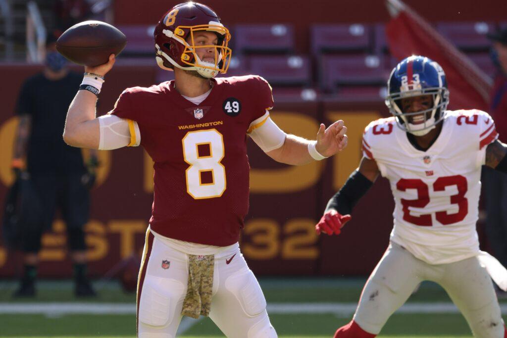 Nov 8, 2020; Landover, Maryland, USA; Washington Football Team quarterback Kyle Allen (8) passes the ball as New York Giants cornerback Logan Ryan (23) chases in the first quarter at FedExField. Mandatory Credit: Geoff Burke-USA TODAY Sports