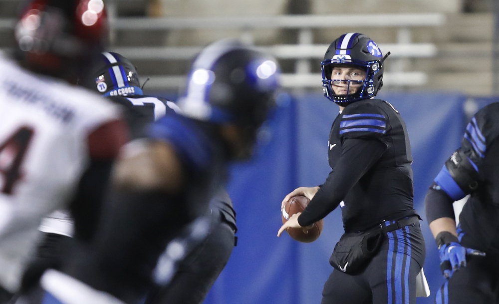 Dec 12, 2020; Provo, UT, USA; BYU quarterback Zach Wilson (1) looks to throw the ball in the first half, of an NCAA college football game against San Diego State Saturday, Dec. 12, 2020, in Provo, Utah.  Mandatory Credit: George Frey/Pool Photo-USA TODAY Sports