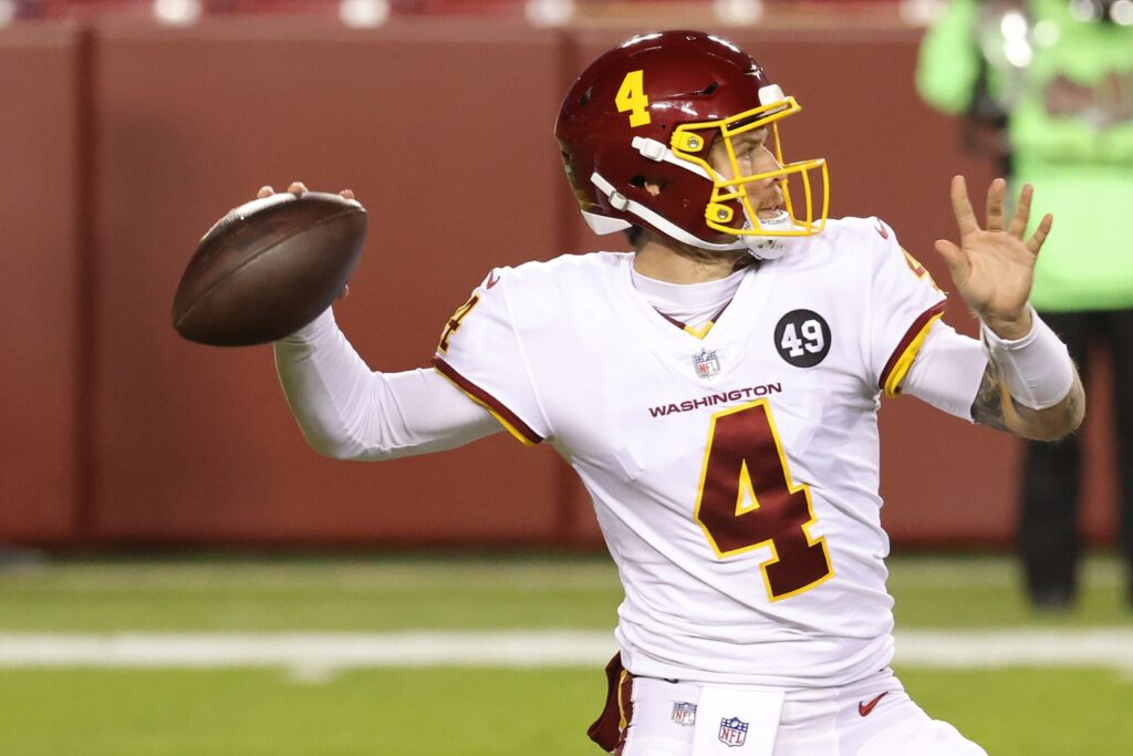 Jan 9, 2021; Landover, Maryland, USA; Washington Football Team quarterback Taylor Heinicke (4) passes the ball against the Tampa Bay Buccaneers in the first quarter at FedExField. Mandatory Credit: Geoff Burke-USA TODAY Sports