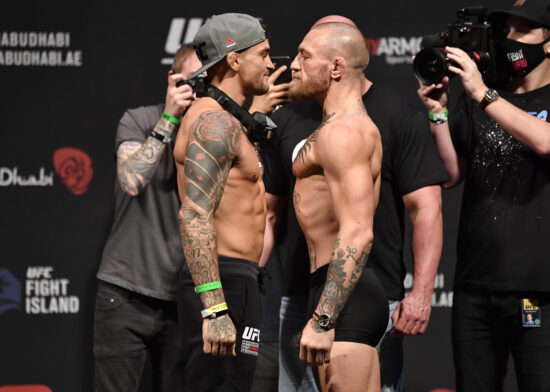 Jan 22, 2021; Abu Dhabi, UNITED ARAB EMIRATES;   Dustin Poirier and Conor McGregor of Ireland face off during the UFC 257 weigh-in at Etihad Arena on UFC Fight Island on January 22, 2021 in Abu Dhabi, United Arab Emirates. Mandatory Credit: Jeff Bottari/Handout Photo via USA TODAY Sports