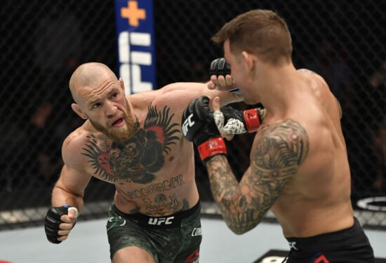 Jan 23, 2021; Abu Dhabi, United Arab Emirates; Conor McGregor of Ireland punches Dustin Poirier in a lightweight fight during the UFC 257 event inside Etihad Arena on UFC Fight Island.  Mandatory Credit: Jeff Bottari/Handout Photo via USA TODAY Sports