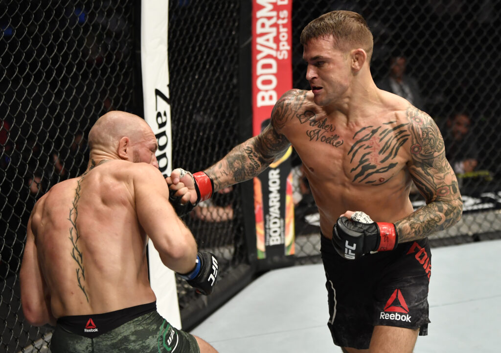 Jan 23, 2021; Abu Dhabi, United Arab Emirates; Dustin Poirier punches Conor McGregor of Ireland in a lightweight fight during the UFC 257 event inside Etihad Arena on UFC Fight Island.  Mandatory Credit: Jeff Bottari/Handout Photo via USA TODAY Sports