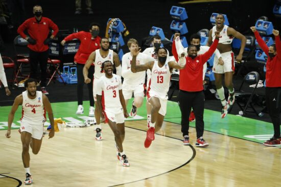Mar 21, 2021; Indianapolis, Indiana, USA; The Houston Cougars bench celebrates after defeating the Rutgers Scarlet Knights in the second round of the 2021 NCAA Tournament at Lucas Oil Stadium. Mandatory Credit: Joshua Bickel-USA TODAY Sports