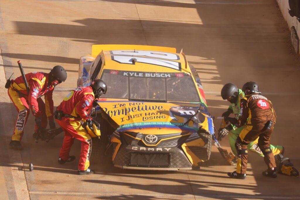 Mar 29, 2021; Bristol, TN, USA; NASCAR Cup Series driver Kyle Busch (18) pits during the Food City Dirt Race at Bristol Motor Speedway. Mandatory Credit: Randy Sartin-USA TODAY Sports
