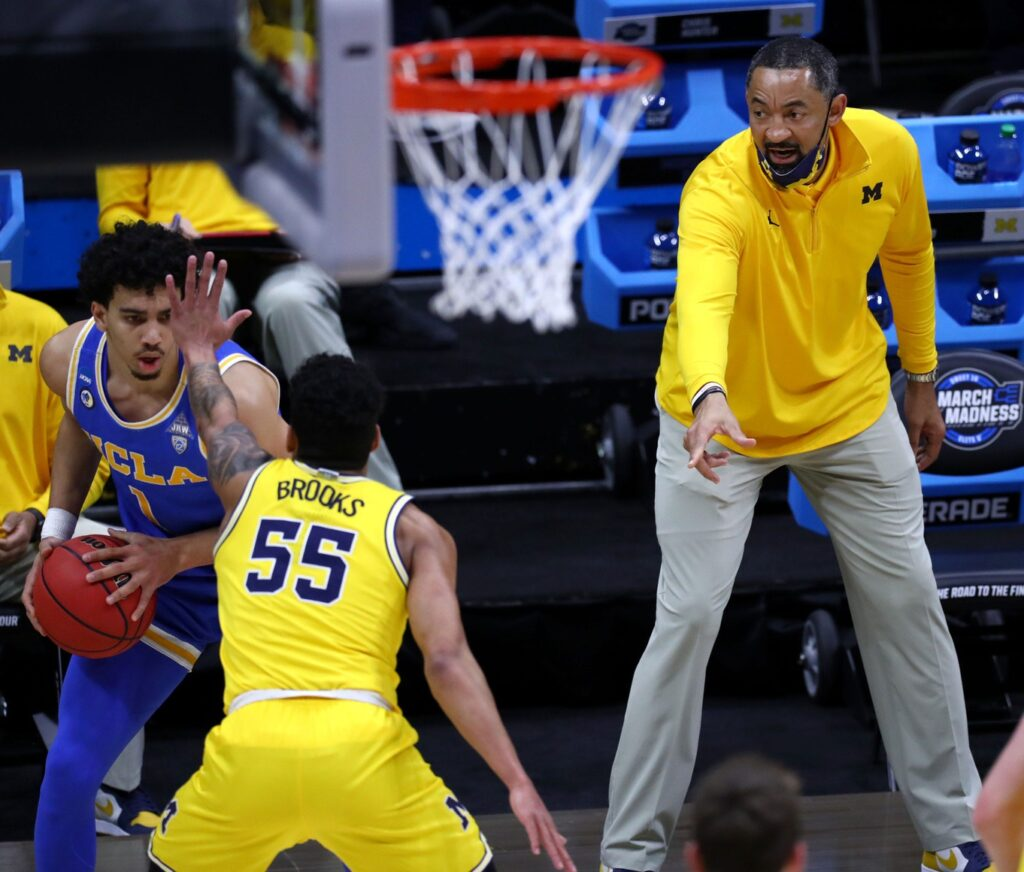 Michigan head coach Juwan Howard yells to Michigan Wolverines guard Eli Brooks (55) as he defends UCLA Bruins guard Jules Bernard (1) during the Elite Eight round of the 2021 NCAA Tournament on Tuesday, March 30, 2021, at Lucas Oil Stadium in Indianapolis, Ind.  Ncaa Basketball Ncaa Tournament Michigan Vs Ucla