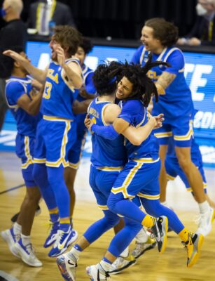 Mar 30, 2021; Indianapolis, IN, USA; UCLA Bruins guard Tyger Campbell (10) celebrates with teammates after advancing to the Final Four following their win in the Elite Eight of the 2021 NCAA Tournament against the Michigan Wolverines at Lucas Oil Stadium. Mandatory Credit: Mark J. Rebilas-USA TODAY Sports