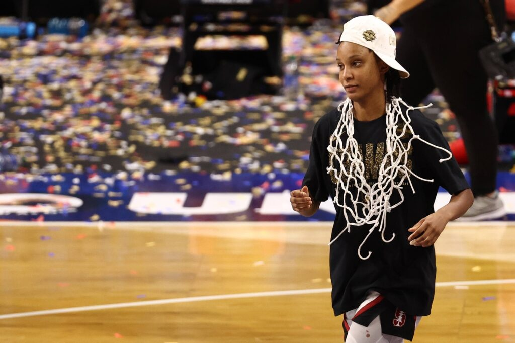 Apr 4, 2021; San Antonio, TX, USA; Stanford Cardinal guard Kiana Williams (23) looks on after cutting the net after winning the national championship game of the women's Final Four of the 2021 NCAA Tournament against the Arizona Wildcats at Alamodome. Mandatory Credit: Troy Taormina-USA TODAY Sports
