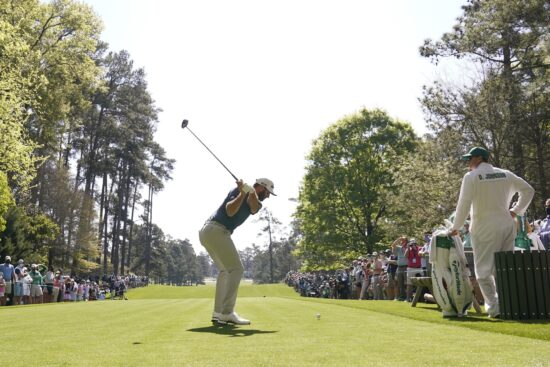 Apr 5, 2021; Augusta, Georgia, USA; Dustin Johnson hits his tee shot on the 7th hole during a practice round for The Masters golf tournament at Augusta National Golf Club. Mandatory Credit: Michael Madrid-USA TODAY Sports