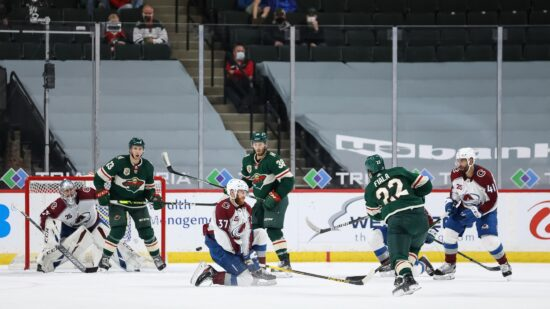 Apr 5, 2021; Saint Paul, Minnesota, USA; Minnesota Wild left wing Kevin Fiala (22) scores a goal against the Colorado Avalanche during the third period at Xcel Energy Center. Mandatory Credit: Harrison Barden-USA TODAY Sports