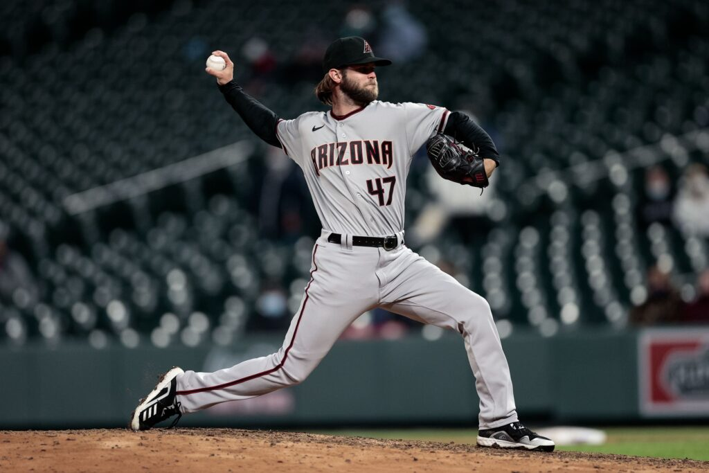 Apr 6, 2021; Denver, Colorado, USA; Arizona Diamondbacks relief pitcher Matt Peacock (47) pitches in the eleventh inning against the Colorado Rockies at Coors Field. Mandatory Credit: Isaiah J. Downing-USA TODAY Sports