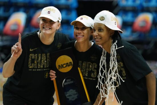 Apr 4, 2021; San Antonio, TX, USA; Stanford Cardinal guard Jana Van Gytenbeek (left), guard Anna Wilson (center) and guard Kiana Williams pose with the national champion trophy after the national championship game of the women's Final Four of the 2021 NCAA Tournament against the Arizona Wildcats at Alamodome. Stanford defeated Arizona 54-53 to win first time since 1992. Mandatory Credit: Kirby Lee-USA TODAY Sports