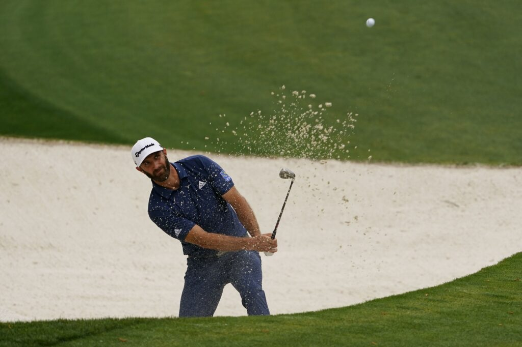 Apr 9, 2021; Augusta, Georgia, USA; Dustin Johnson hits from the sand on the 10th hole during the second round of The Masters golf tournament. Mandatory Credit: Michael Madrid-USA TODAY Sports