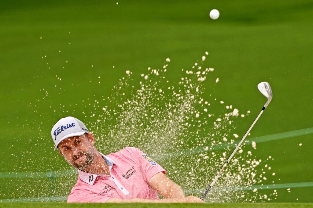 Apr 10, 2021; Augusta, Georgia, USA; Webb Simpson plays a shot from a bunker on the second hole during the third round of The Masters golf tournament. Mandatory Credit: Michael Madrid-USA TODAY Sports