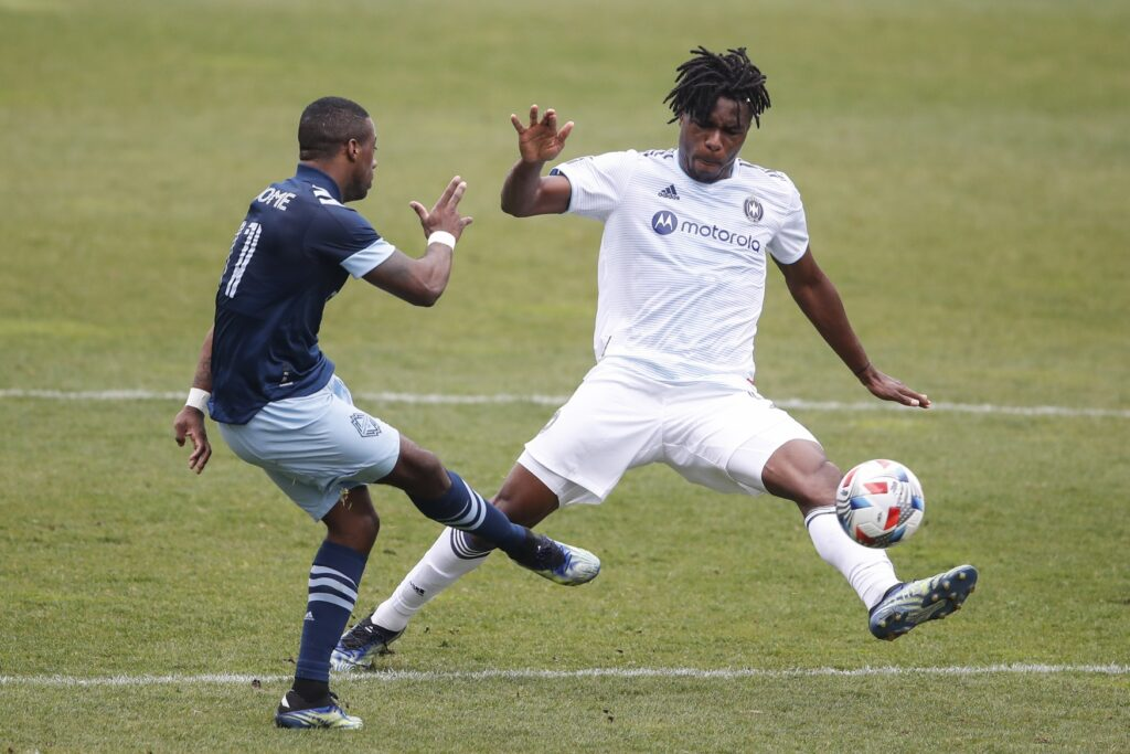 Apr 10, 2021; Bridgeview, Illinois, USA; Chicago Fire FC forward Chinonso Offor (9) defends against Vancouver Whitecaps FC forward Cristian Dajome (11) during the first half of an MLS preseason match at SeatGeek Stadium. Mandatory Credit: Kamil Krzaczynski-USA TODAY Sports