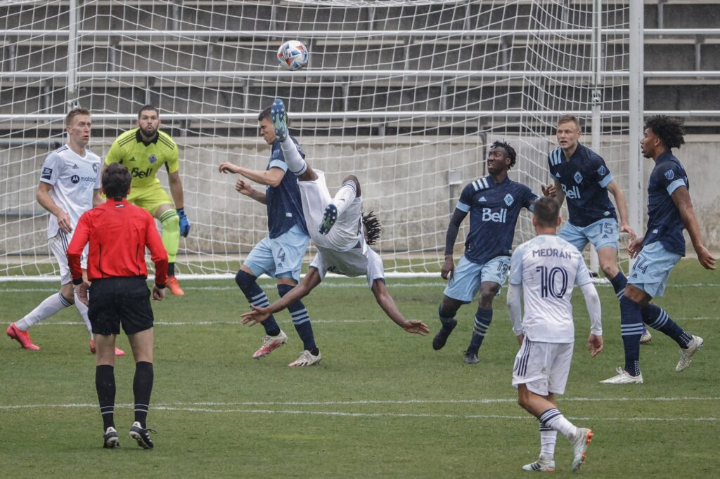 Apr 10, 2021; Bridgeview, Illinois, USA; Chicago Fire FC forward Chinonso Offor (9) tries to score against the Vancouver Whitecaps FC during the second half of an MLS preseason match at SeatGeek Stadium. Mandatory Credit: Kamil Krzaczynski-USA TODAY Sports