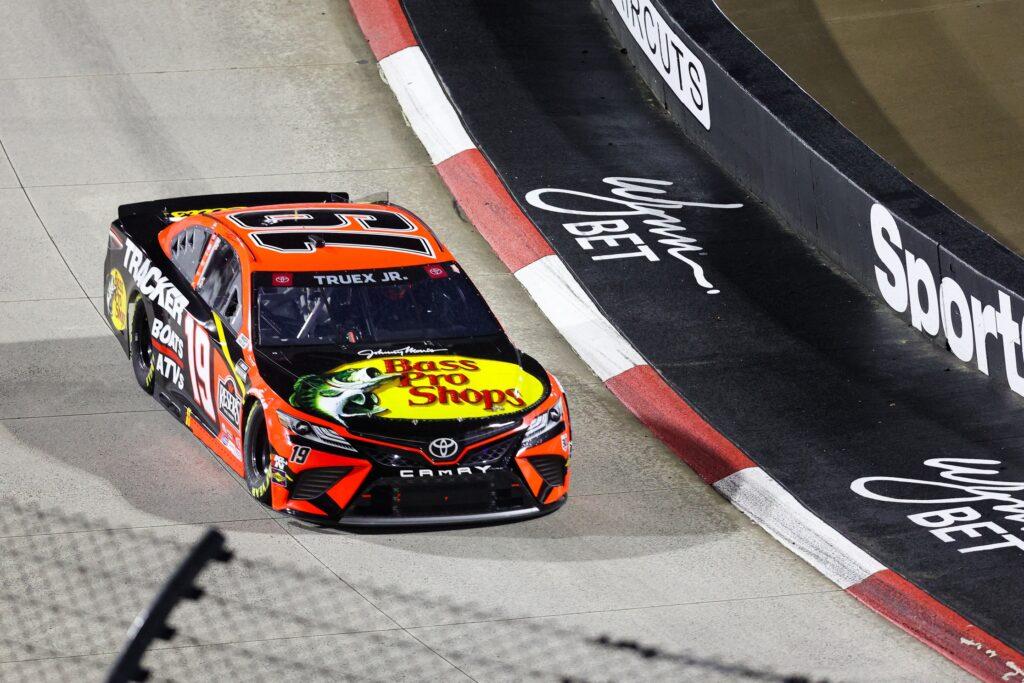 Apr 10, 2021; Martinsville, Virginia, USA; NASCAR Cup Series driver Martin Truex Jr. (19) races at the Blue-Emu Maximum Pain Relief 500 at Martinsville Speedway. Mandatory Credit: Ryan Hunt-USA TODAY Sports