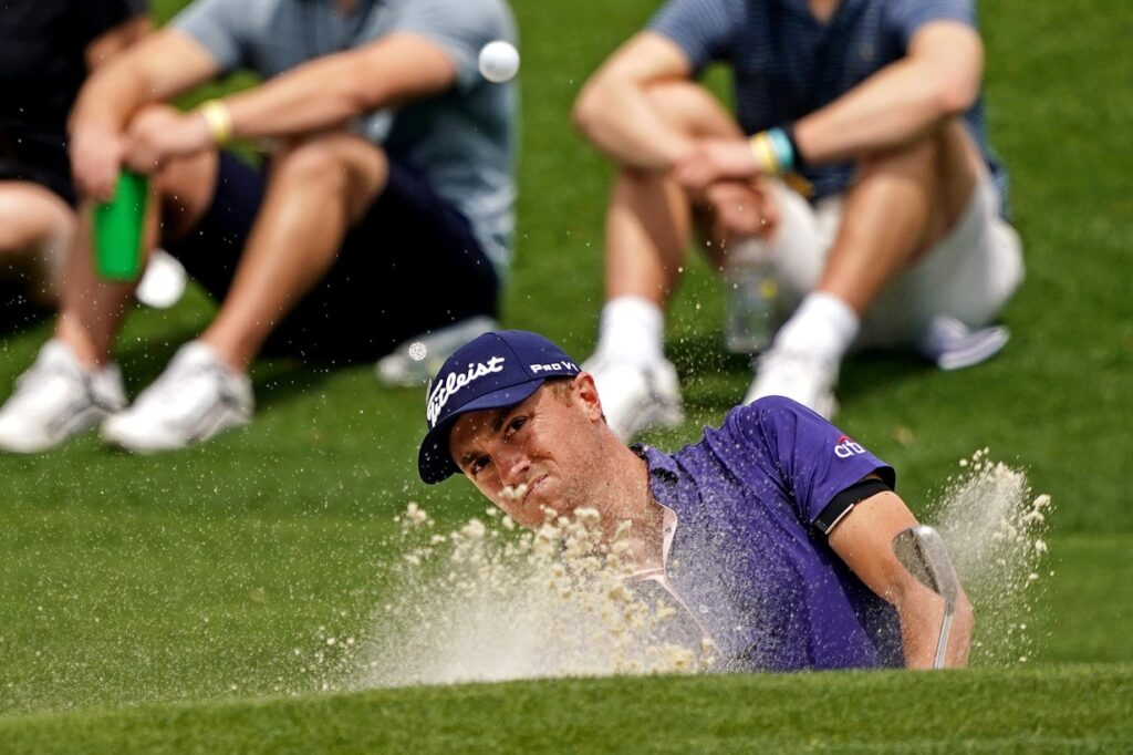 Apr 11, 2021; Augusta, Georgia, USA; Justin Thomas plays a shot from a bunker on the second hole during the final round of The Masters golf tournament. Mandatory Credit: Michael Madrid-USA TODAY Sports