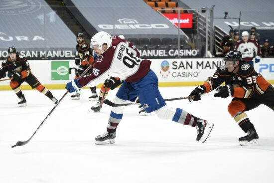Apr 11, 2021; Anaheim, California, USA; Colorado Avalanche left wing Mikko Rantanen (96) shoots while defened by Anaheim Ducks right wing Jakob Silfverberg (33) during the first period at Honda Center. Mandatory Credit: Kelvin Kuo-USA TODAY Sports