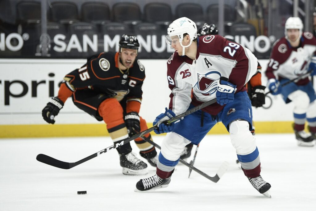 Apr 11, 2021; Anaheim, California, USA; Colorado Avalanche right wing Nathan MacKinnon (29) handles the puck during the third period against the Anaheim Ducks at Honda Center. Mandatory Credit: Kelvin Kuo-USA TODAY Sports