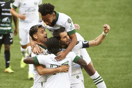 Apr 13, 2021; Portland, Oregon, USA; Portland Timbers forward Yimmi Chara (23) celebrates with teammates after scoring a goal during the first half against Marathon at Providence Park. Mandatory Credit: Troy Wayrynen-USA TODAY Sports