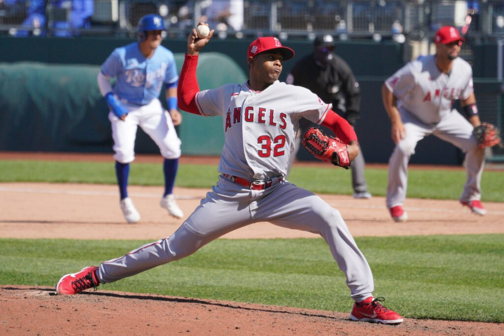 Apr 14, 2021; Kansas City, Missouri, USA; Los Angeles Angels relief pitcher Raisel Iglesias (32) delivers a pitch in the eighth inning against the Kansas City Royals at Kauffman Stadium. Mandatory Credit: Denny Medley-USA TODAY Sports