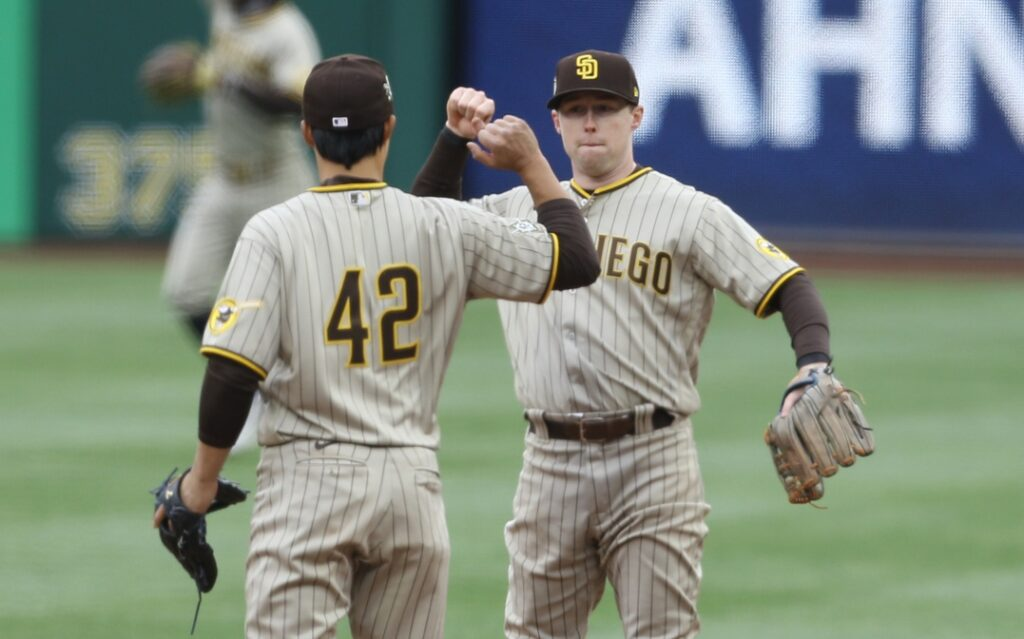 Apr 15, 2021; Pittsburgh, Pennsylvania, USA; San Diego Padres shortstop Ha-Seong Kim (left) and second baseman Jake Cronenworth (right) celebrate after defeating the Pittsburgh Pirates at PNC Park. San Diego won 8-3. Mandatory Credit: Charles LeClaire-USA TODAY Sports