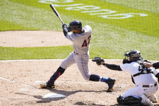 Apr 15, 2021; Chicago, Illinois, USA; Cleveland Indians left fielder Eddie Rosario hits a single against the Chicago White Sox during the sixth inning at Guaranteed Rate Field. All players on both teams are wearing number 42 in honor of Jackie Robinson Day. Mandatory Credit: David Banks-USA TODAY Sports