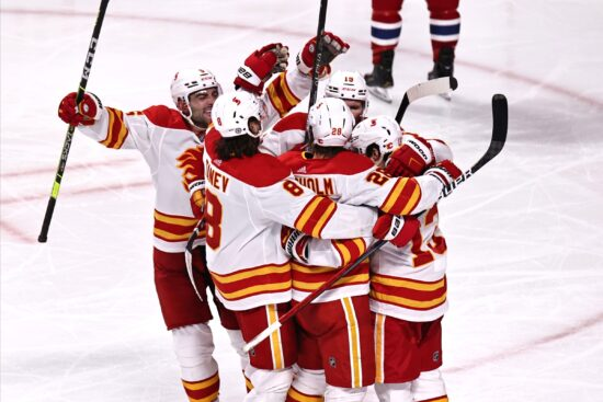 Apr 16, 2021; Montreal, Quebec, CAN; Calgary Flames center Elias Lindholm (28) celebrates his goal against Montreal Canadiens with teammates during the third period at Bell Centre. Mandatory Credit: Jean-Yves Ahern-USA TODAY Sports