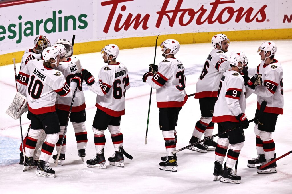 Apr 17, 2021; Montreal, Quebec, CAN; Ottawa Senators players celebrate their win against Montreal Canadiens at Bell Centre. Mandatory Credit: Jean-Yves Ahern-USA TODAY Sports