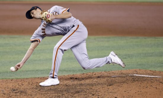 Apr 18, 2021; Miami, Florida, USA; San Francisco Giants pitcher Tyler Rogers (71) throws against the Miami Marlins during the ninth inning at loanDepot Park. Mandatory Credit: Rhona Wise-USA TODAY Sports