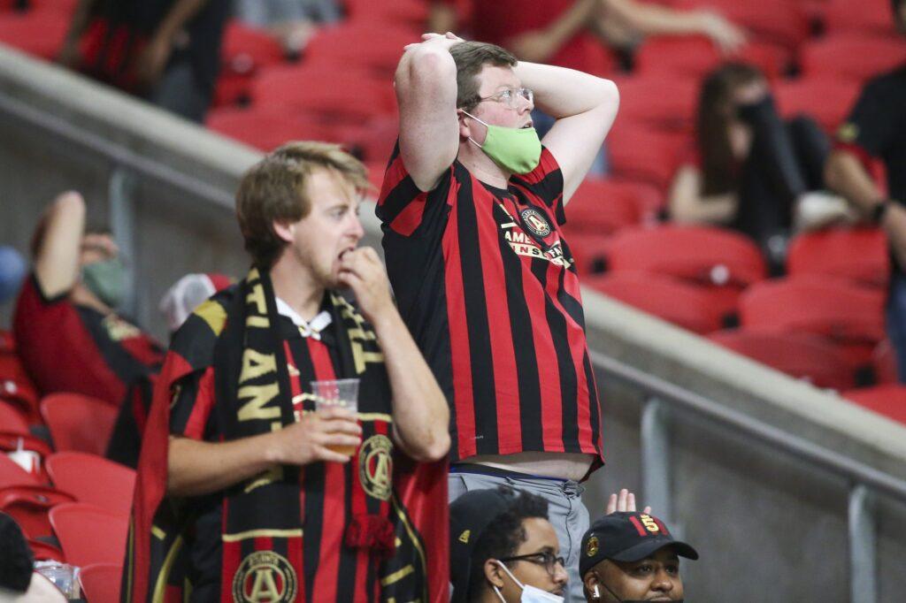 Apr 27, 2021; Atlanta, Georgia, USA; Atlanta United fans show emotion against the Philadelphia Union in the second half at Mercedes-Benz Stadium. Mandatory Credit: Brett Davis-USA TODAY Sports