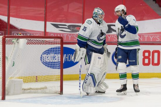 Apr 28, 2021; Ottawa, Ontario, CAN; Vancouver Canucks center Zack MacEwen (71) speaks with goalie Thatcher Demko (35) following a goal scored by the Ottawa Senators in the second period at the Canadian Tire Centre. Mandatory Credit: Marc DesRosiers-USA TODAY Sports
