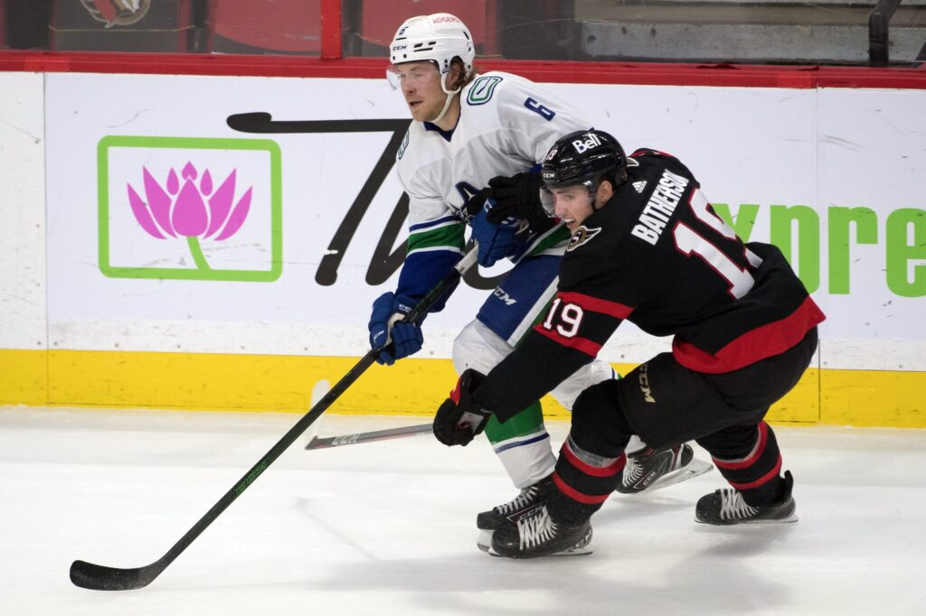 Apr 28, 2021; Ottawa, Ontario, CAN; Vancouver Canucks right wing Brock Boeser (6) battles with Ottawa Senators right wing Drake Batherson (19) in the third period at the Canadian Tire Centre. Mandatory Credit: Marc DesRosiers-USA TODAY Sports