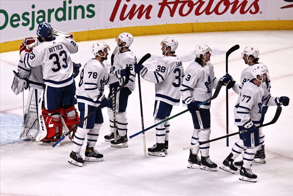 Apr 28, 2021; Montreal, Quebec, CAN; Toronto Maple Leafs players celebrate their win against Montreal Canadiens at Bell Centre. Mandatory Credit: Jean-Yves Ahern-USA TODAY Sports