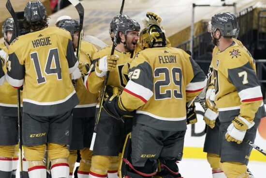 Las Vegas, Nevada, USA; Vegas Golden Knights defenseman Alec Martinez, center left, celebrates with goaltender Marc-Andre Fleury (29) after defeating the Colorado Avalanche at T-Mobile Arena. Mandatory Credit: John Locher/POOL PHOTOS-USA TODAY Sports