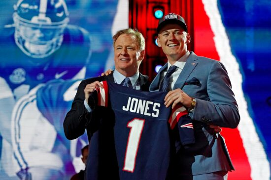 Apr 29, 2021; Cleveland, Ohio, USA; Mac Jones (Alabama) with NFL commissioner Roger Goodell after being selected by the New England Patriots as the number 15 overall pick in the first round of the 2021 NFL Draft at First Energy Stadium. Mandatory Credit: Kirby Lee-USA TODAY Sports