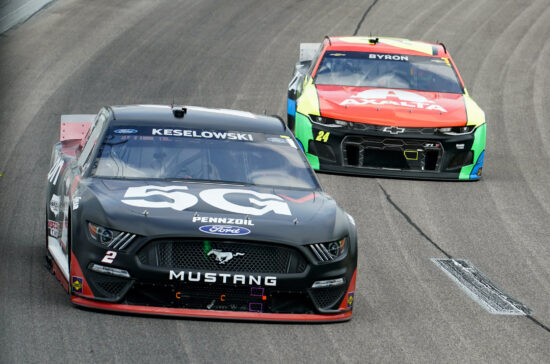 May 2, 2021; Kansas City, Kansas, USA; NASCAR Cup Series driver Brad Keselowski (2) leads driver William Bryon (24) during the Buschy McBusch Race 400 at Kansas Speedway. Mandatory Credit: Jay Biggerstaff-USA TODAY Sports