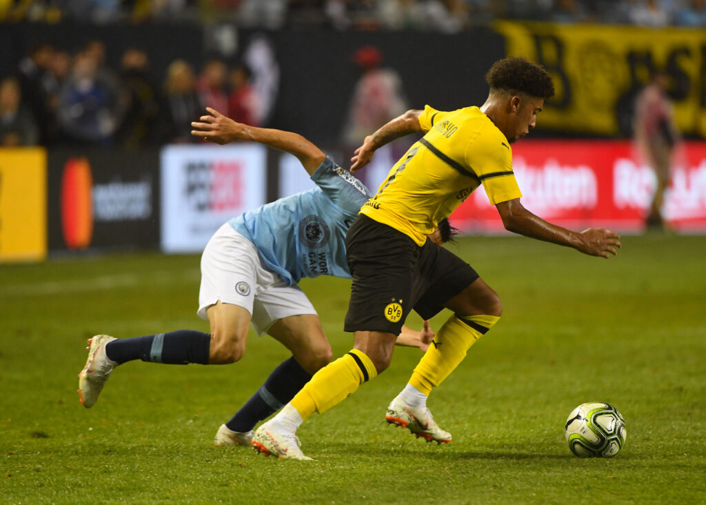 Jul 20, 2018; Chicago, IL, USA;  Borussia Dortmund midfielder Jadon Sancho (7) steals the ball from Manchester City forward Patrick Roberts (27) during an International Champions Cup soccer match at Soldier Field. Mandatory Credit: Mike DiNovo-USA TODAY Sports