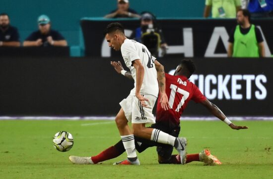 Jul 31, 2018; Miami, FL, USA; Manchester United midfielder Fred (17) steals the ball from Real Madrid defender Sergio Reguilon (29) during the second half of an International Champions Cup soccer match at Hard Rock Stadium. Mandatory Credit: Jasen Vinlove-USA TODAY Sports