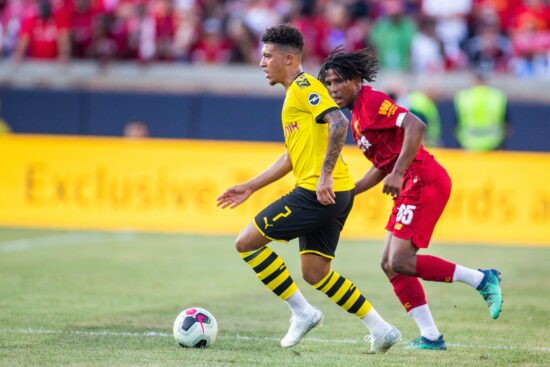 Jul 19, 2019; South Bend, IN, USA; Borussia Dortmund midfielder Jadon Sancho (7) dribbles the ball while Liverpool forward Yasser Larouci (65) defends in the first half of a pre-season preparation soccer match at Notre Dame. Mandatory Credit: Trevor Ruszkowski-USA TODAY Sports