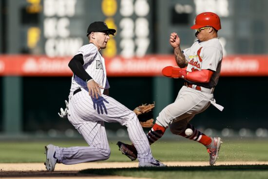 Sep 12, 2019; Denver, CO, USA; St. Louis Cardinals second baseman Kolten Wong (16) safely steals second base as Colorado Rockies second baseman Ryan McMahon (24) is unable to field the ball in the ninth inning at Coors Field. Mandatory Credit: Isaiah J. Downing-USA TODAY Sports