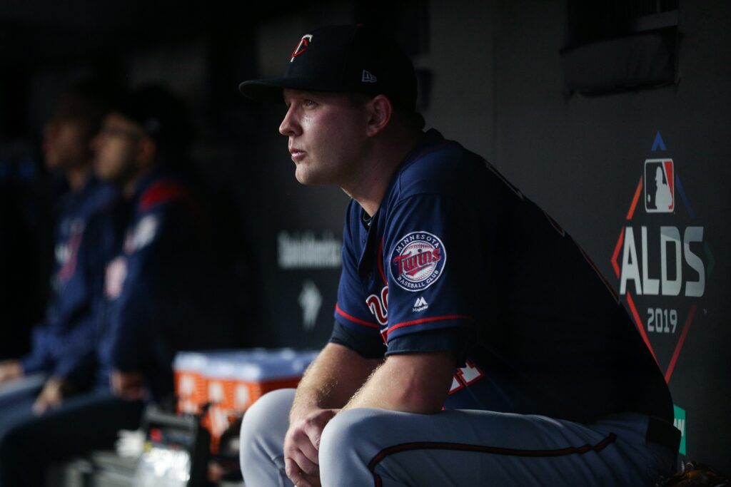 Oct 5, 2019; Bronx, NY, USA; Minnesota Twins relief pitcher Tyler Duffey (21) reacts as he sits in the dugout during the game against the New York Yankees in game two of the 2019 ALDS playoff baseball series at Yankee Stadium. Mandatory Credit: Brad Penner-USA TODAY Sports