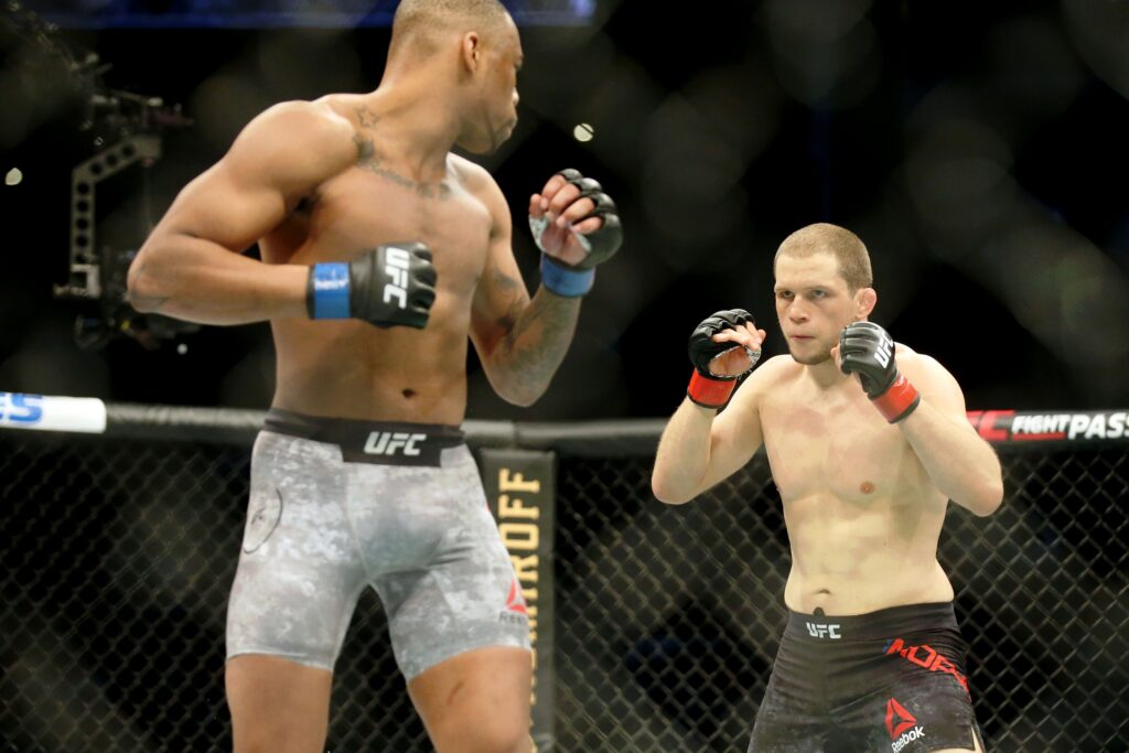 Feb 8, 2020; Houston, Texas, USA; Alex Morono (red gloves) fights Khaos Williams (blue gloves) during UFC 247 at Toyota Center. Mandatory Credit: Thomas Shea-USA TODAY Sports