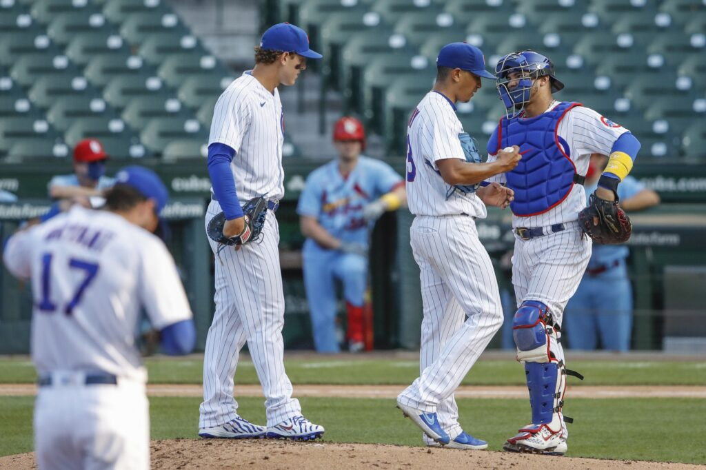 Sep 5, 2020; Chicago, Illinois, USA; Chicago Cubs catcher Willson Contreras (40) talks with starting pitcher Adbert Alzolay (73) during the third inning at Wrigley Field. Mandatory Credit: Kamil Krzaczynski-USA TODAY Sports