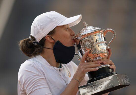 Oct 10, 2020; Paris, France; Iga Swiatek (POL) kisses the trophy after her match against Sofia Kenin (USA) on day 14 at Stade Roland Garros. Mandatory Credit: Susan Mullane-USA TODAY Sports